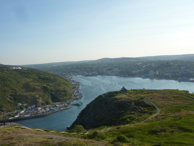St John's  view from the top of Signal Hill. Ships enter the harbour through a narrow entrance.